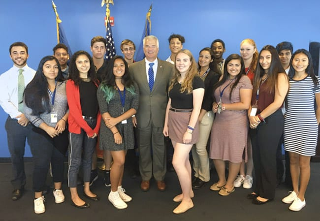 District Attorney Michael McMahon with his interns